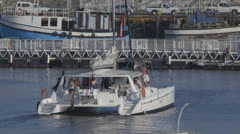 Boat leaving harbor Stock Footage