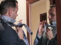 Businessman tying necktie in front of the mirror NTSC Stock Footage