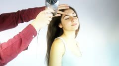 Hairdresser drying very long hair of client Stock Footage
