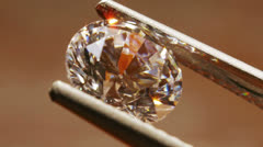 Diamond Seen Close Up With Pincers Stock Footage