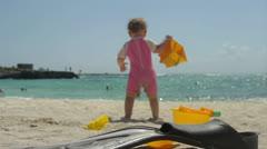 Baby walking to Ocean Stock Footage