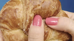 Breaking Croissant Slow Motion - stock footage