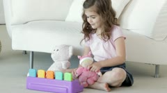 Caucasian girl playing with toys Stock Footage