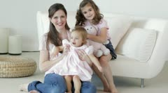 Caucasian mother and girls waving Stock Footage