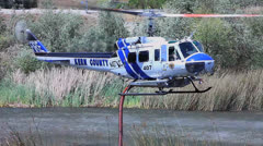FIRE COPTER TAKES ON WATER Stock Footage