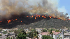 HOMES IN PATH OF BRUSH FIRE - stock footage