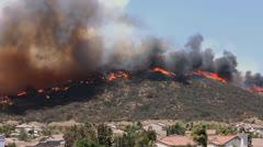 BRUSH FIRE BURNS TOWARD HOMES Stock Footage