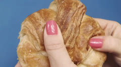 Breaking Croissant Apart Slow Motion - stock footage