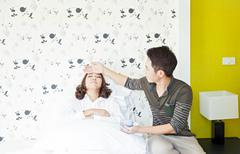 husband takecare his sick wife - stock photo