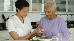 Senior woman with caregiver taking medication Stock Footage
