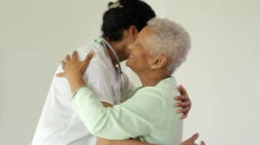 Close up of doctor and senior woman Stock Footage