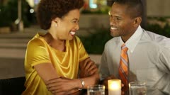 African American couple in cafe with gift Stock Footage