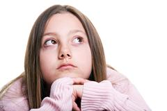 Young girl hoping or wishing isolated - stock photo