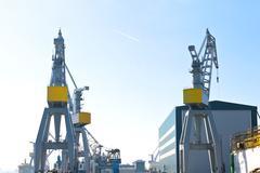 Cranes in the shipyard. morning Stock Photos