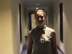 Young happy businesswoman walking in hall, steadicam shot NTSC Stock Footage