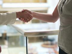 Closeup of a business hand shake between two businesswomen NTSC Stock Footage