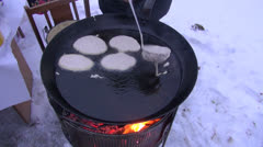 Cooking pancake in winter  Tuesday festival. Pancake day Stock Footage