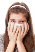 teenager girl in surgical mask - stock photo