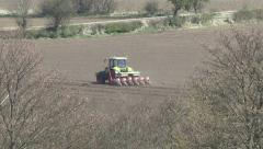 Tractor tows seed drill, seen through heat haze. Stock Footage