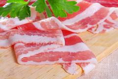 appetizing bacon on the wooden background - stock photo