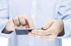 Man operating a touchscreen mobile phone Stock Photos