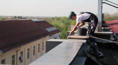 Alpinist Worker Preparing Safety Ropes on the Roof Stock Footage