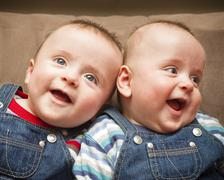Stock Photo of Twin boys in overalls smiling