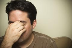 A man with sinus pain or a headache - stock photo