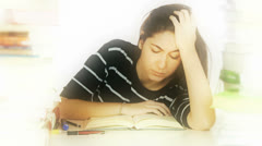 Tired student woman falling asleep on book - stock footage
