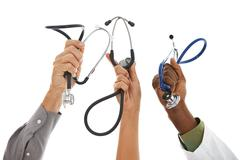 Doctors: hands in the air with stethoscopes Stock Photos