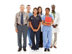 doctors: cheerful group of physicians and nurses - stock photo