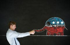 man pulling republican democracy elephant on blackboard background - stock photo