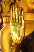 Hand of buddha statue Stock Photos