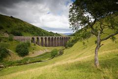 Viaduct in english countryside on cloudy day Stock Photos