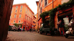 Typical street in Rome, Italy. Colorful buildings - Trastevere Stock Footage