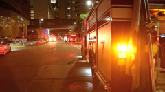 Firetrucks with Lights Flashing on City Street Stock Footage