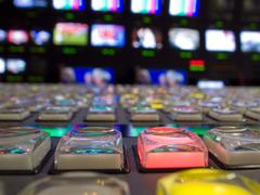 video switcher in television control room - stock photo
