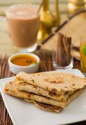 chapati , indian flat bread in plate usually served with curry - stock photo
