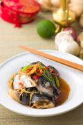 steam fish head soy sauce, patin steamed with chinese style soya sauce and gi - stock photo