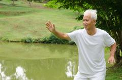 Asian senior male workout in the park Stock Photos