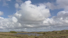Cumulus clouds above coastal landscape and rugged peatland Stock Footage