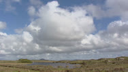 Stock Video Footage of Cumulus clouds above coastal landscape and rugged peatland