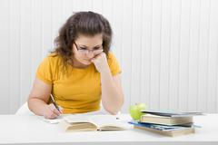 the girl the student with writing-books and books - stock photo