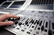 Stock Photo of hand on a sound fader in television gallery