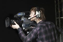 Toimiva ihminen TV-studio kamera Kuvituskuvat