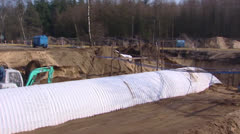 Pan + hold construction of a Wildlife Crossing - underpass tunnel Stock Footage