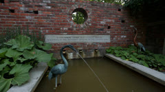 PARK, BIRD FOUNTAIN, POETRY ON BRICK WALL Stock Footage