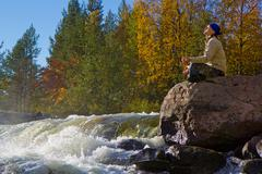 meditation at the falls - stock photo