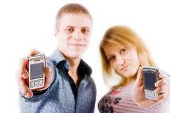 Young people with mobile phones Stock Photos