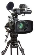 Television camera on tripod against white background Stock Photos